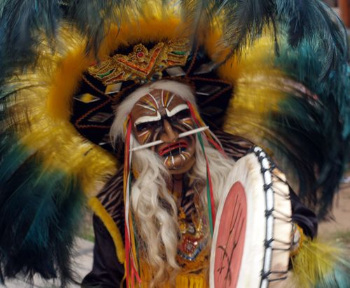 the Indian shaman play on drum